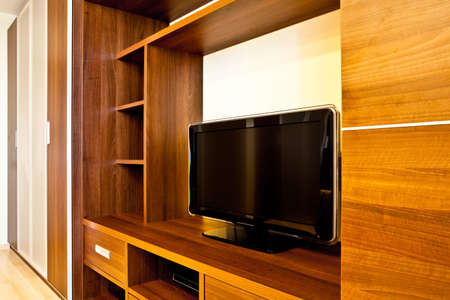 built: Comfortable room with TV and wardrobes Stock Photo