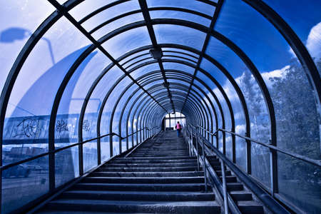 Blue corridor and stairs, people moving Stock Photo - 5492412