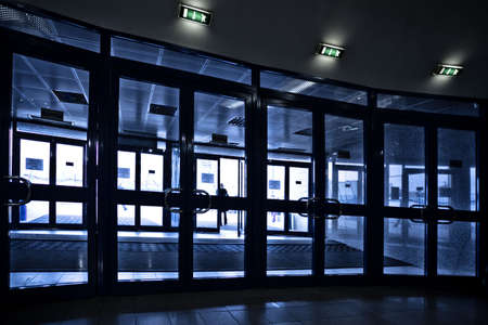 Doors silhouettes at modern airport building photo