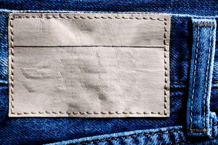 Denim background with blank label photo