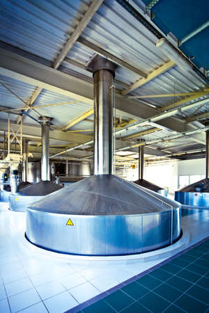 On the territory of brewer's plant with steel fermentation vat Stock Photo