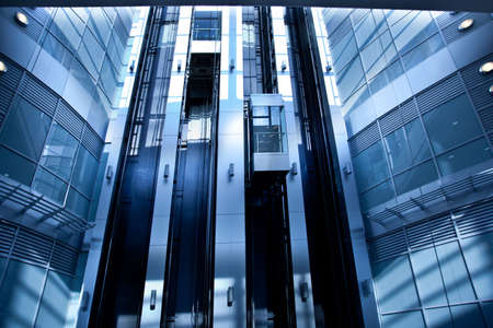 Lifts in modern interior in blue