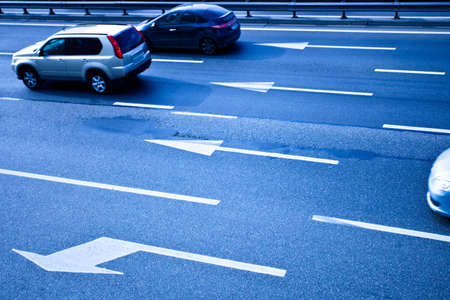 Cars on asphalt road with poits in blue Stock Photo - 5855077