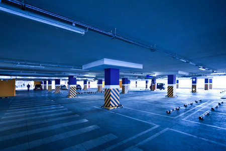 View to empty parking with several autos in blue