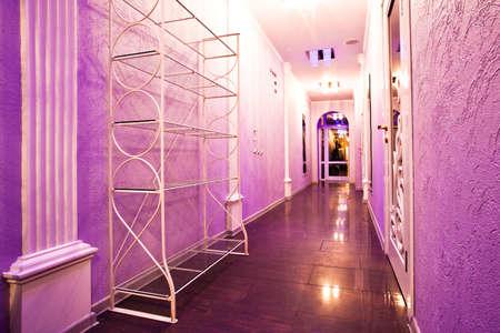 Long purple corridor in barbershop interior with mirrors Stock Photo - 5875829
