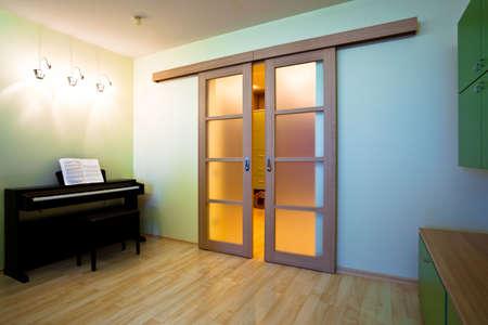Piano in modern room interior