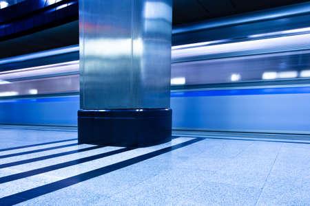 Underground blue platform interior with move train