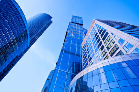 Modern blue skyscrapers towers in business centre perspective view photo