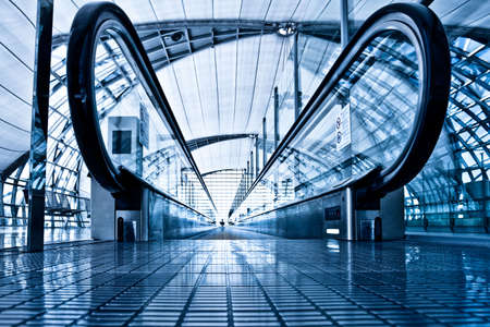 metallic stairs: Enter to blue travolator in modern airport hall