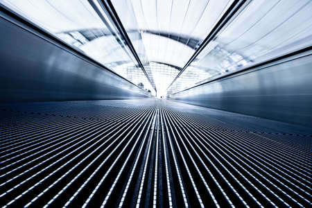 Moving blue travelator in office hall Stock Photo