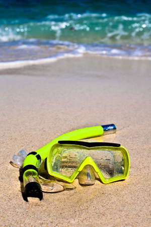 Yellow snorling mask on sand on the beach Stock Photo - 6033805