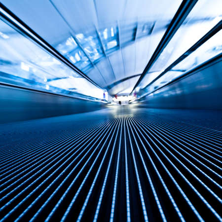 public transportation: Moving blue travelator in office hall, square composition