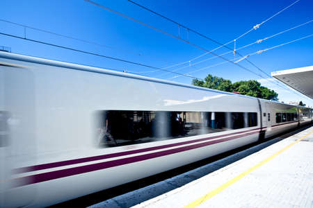 Move train on railway station Stock Photo
