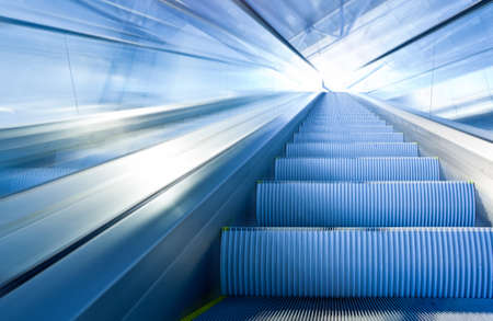 commercial vehicle: Fast escalator move in office centre Stock Photo