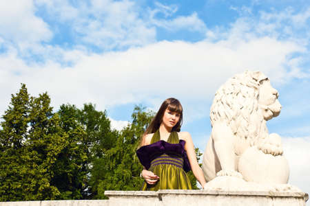 Girl portrait with lion statue photo