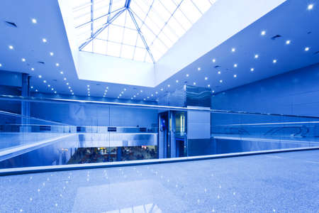 Empty office centre in blue with fifts and escalators