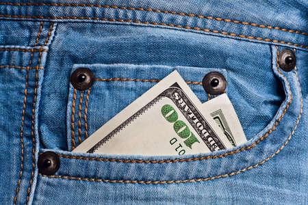 Jeans pocket with one hundred dollars banknotes  photo