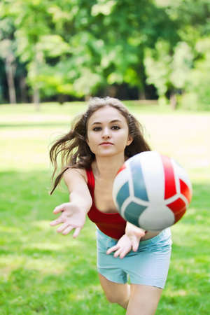 Attractive girl play with volleyball ball photo
