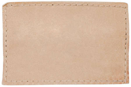 Blank leather jeans label isolated on white photo