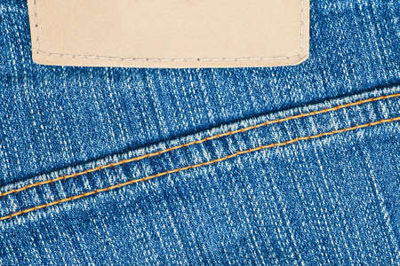 zigzagger: Blank leather label on blue jeans