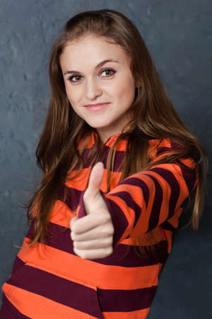 Portrait of young girl showing gesture All right! Stock Photo - 8803802