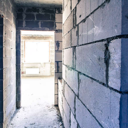 deadlock: Corridor in reconstructioned house, grey brick walls