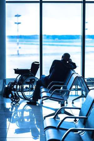 Disabled person in the interior of the airport photo