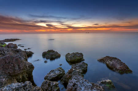 bright after sunset sea with amazing sky photo