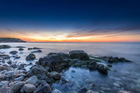 stupendous: stupendous rocky seacost with silky ocean