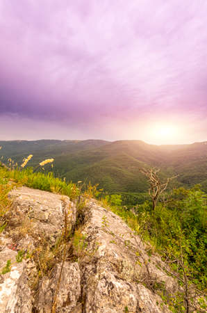 view of sun lazily rising from behind the mountains photo