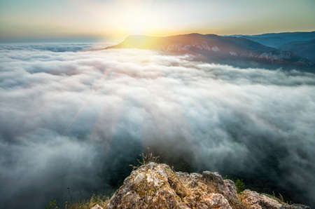 sunset from the top of the mountain above the clouds photo