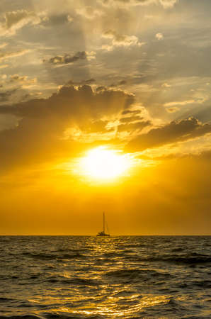 fishing boat goes sailing at sunset photo