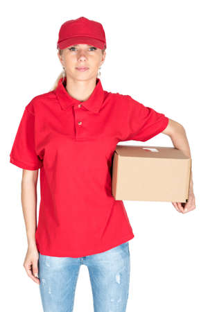 suite: Young woman courier in red suite hold parcel under arm isolated Stock Photo