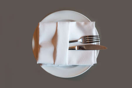 A soft toned image of a table setting with plate, napkin and utensils Stock Photo - 29907890