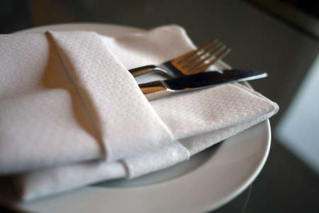 A soft toned image of a table setting with plate, napkin and utensils Stock Photo - 29907907