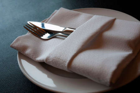 A soft toned image of a table setting with plate, napkin and utensils Stock Photo - 29907908