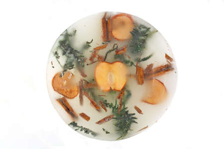 beeswaxseals: Pine branch and apple pieces into the wax Stock Photo