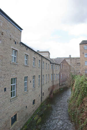 Old Woollen and Carpet Mills by a mill stream in halifax west yorkshire Stock Photo - 9091109