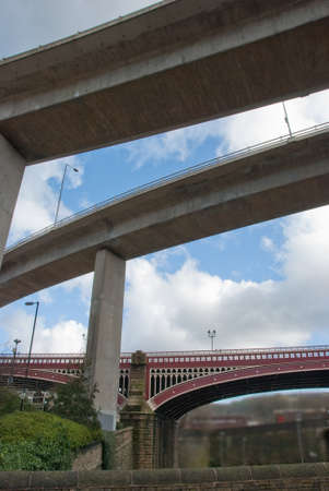 Old victorian bridge overshadowed by flyovers in halifax west yorkshire Stock Photo - 9091108