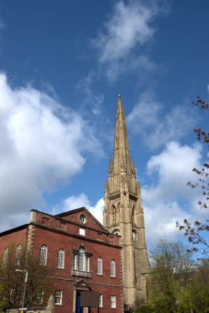 A red brick former chapel and a ruined church spire in Halifax Yorkshire Stock Photo - 9318716