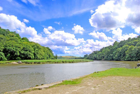 The Tamar River on the border of Devon and Cornwall under a blue sky Stock Photo - 9379074