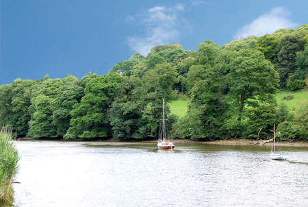 A Peaceful Scene of a Yacht on the Tamar River on the Border of Devon and Cornwall England