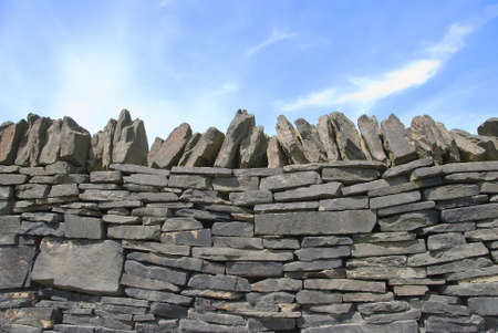 drystone: A Drystone Wall under a blue sky on moorland in Yorkshire Stock Photo