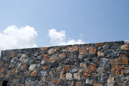 A Typical Dry Stone Wall from the Greek Island of  Crete under a blue summer sky Stock Photo - 9761932