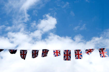 A String of Union Jack Flags across the main street in Haworth Yorkshire Stock Photo - 9762193
