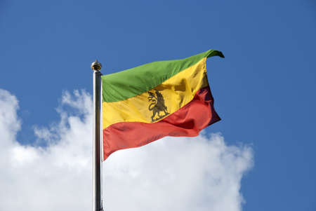 An Ethiopian Flag fluttering in the wind under a blue sky photo