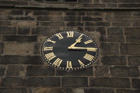 A Vintage Black and Gold Clock on a Church Tower Stock Photo - 10298408