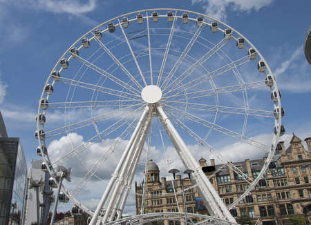 A Fairground Wheel on a city shopping plaza Stock Photo - 10321605