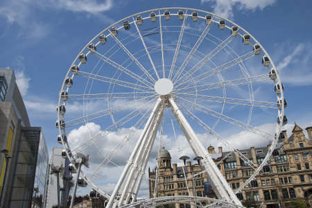 A Fairground Wheel on a city shopping plaza Editorial
