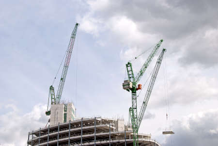Three Heavy Lift Cranes ontop of a construction site Stock Photo - 10321601